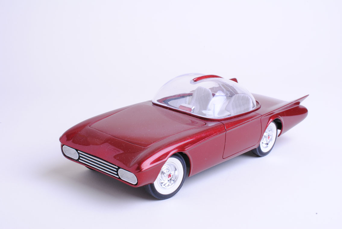 The front and rear rolled pans, and the taillight grille shell, were all attached to the body and then the seams filled with Eurosoft catalyzed polyester putty. The rear deck isn't close to accurate – it's just flat in this model instead of reflecting the underlying shape of a 1956 T-Bird hood which appears on the 1:1 car.