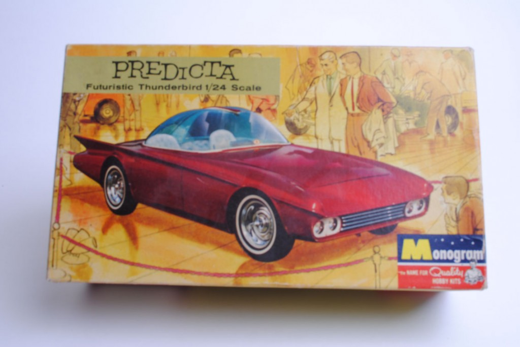The cover of the second box featured an actual photograph of the car, ostensibly on display at the 1964 New York Auto Show (though we've not been able to confirm this claim). An artist created an impressionistic background of a couple early Sixties bon-vivants talking about the car in a car show setting.
