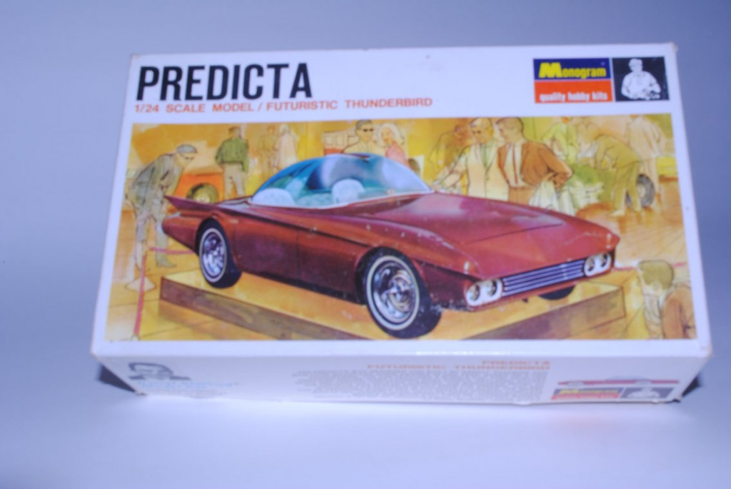 The third box art strongly resembled the second kit box, but the background was dropped in relation to a photo of the car that had faded quite a bit (the rich color of the photo on the second box lid was diminished).